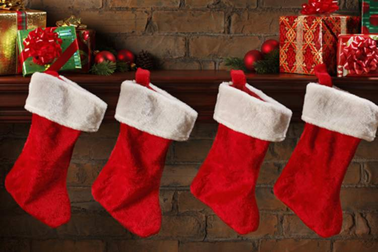 Christmas stockings hung on fireplace mantle.