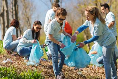 Young people volunteering clean up image.