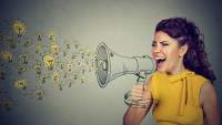 Woman yelling her ideas into a megaphone.