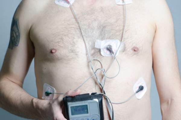 Holter monitor hooked up to man.