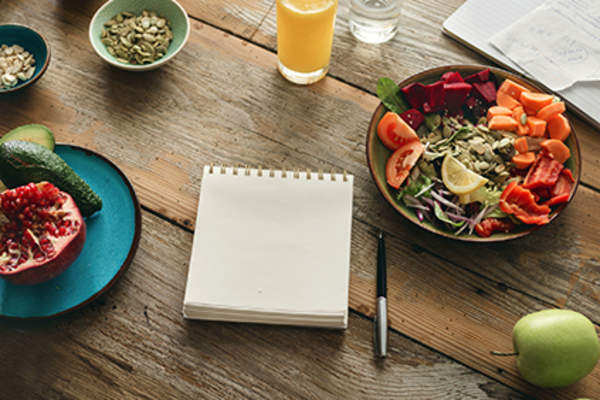 Notepad to write down a food log.