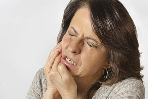 Woman with mouth pain.