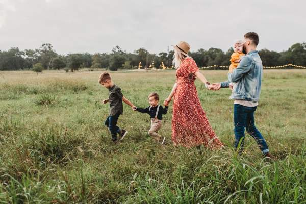 family walking through field