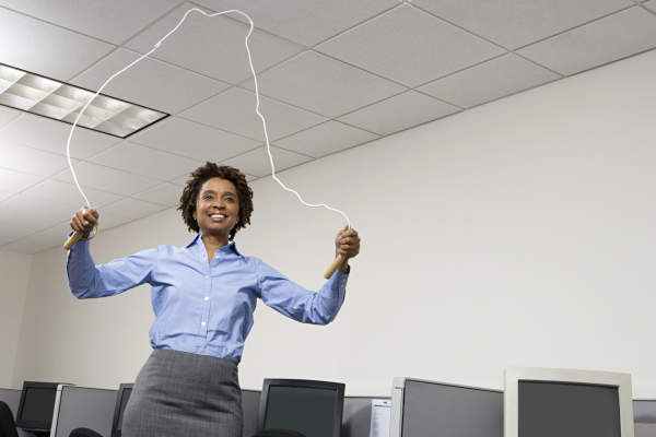 Woman skipping in office