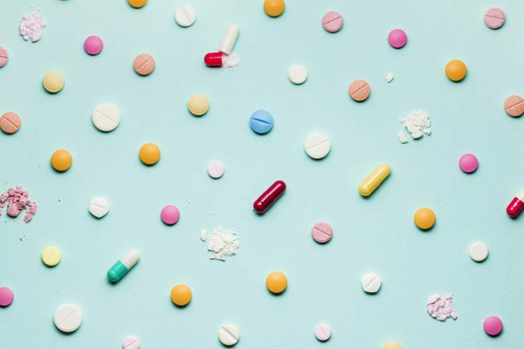 Medications on light blue background.