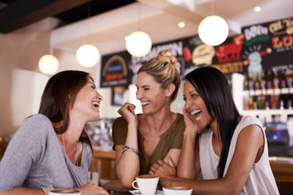 Three women chatting over coffee, two out of every three individuals who experienced weekly heartburn reported that their symptoms affected their ability to sleep.