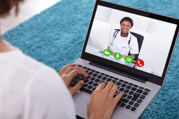 Woman in live chat with medical professional.