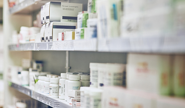 Medications on a pharmacy shelf.