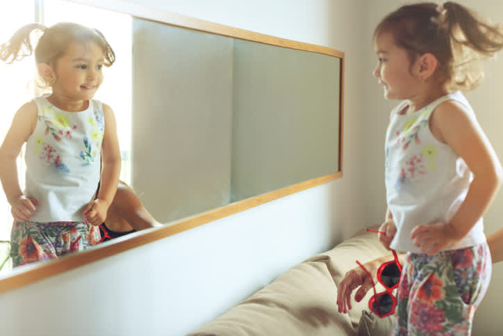 young child in mirror