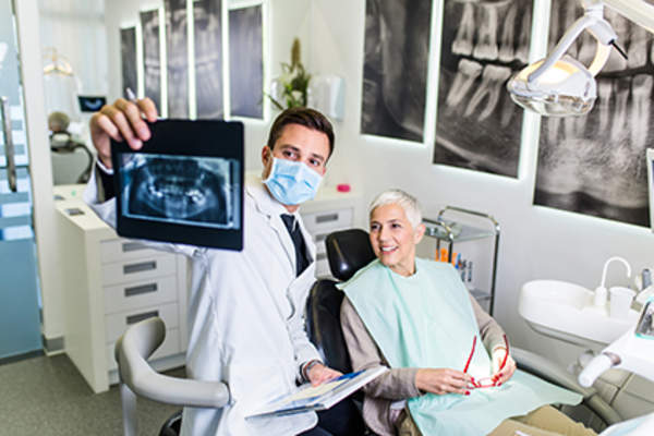 Dentist showing a patient her dental x-rays.