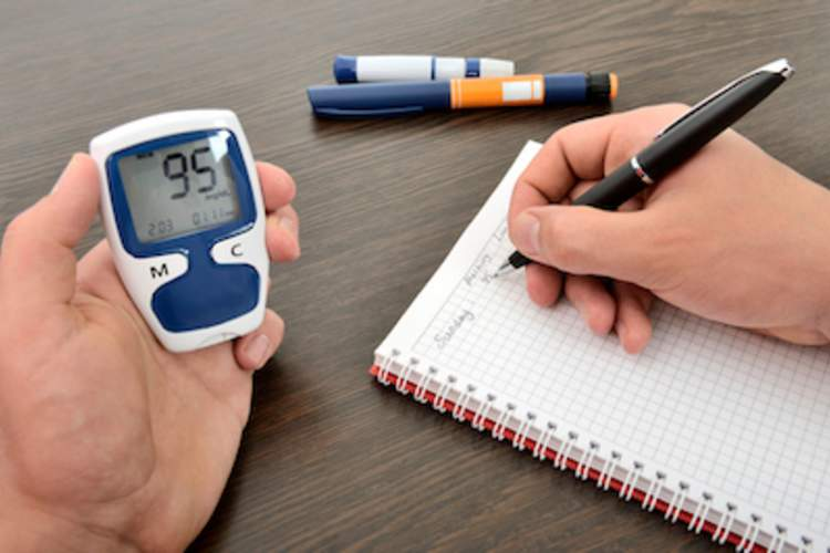 A patient with diabetes logging his blood sugar levels.