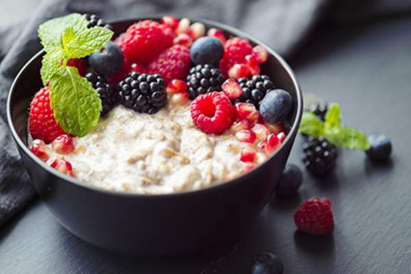 Healthy porridge topped with berries.