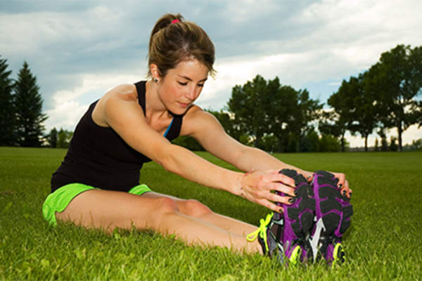Woman stretching hamstring muscles.