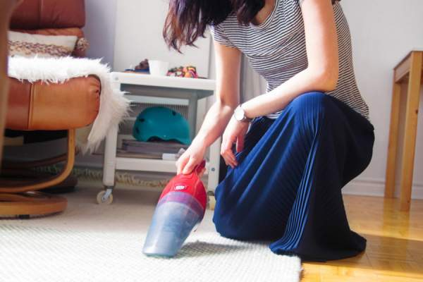 woman with handheld vacuum