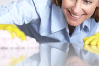 woman smiling while cleaning