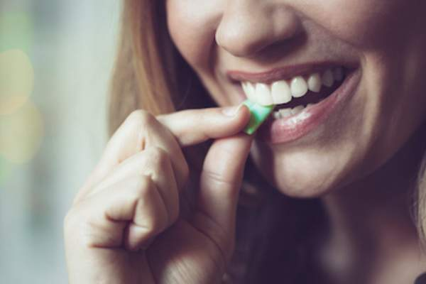 Chewing gum to break stress eating habit.