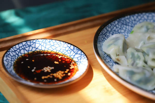 soy sauce next to dumplings