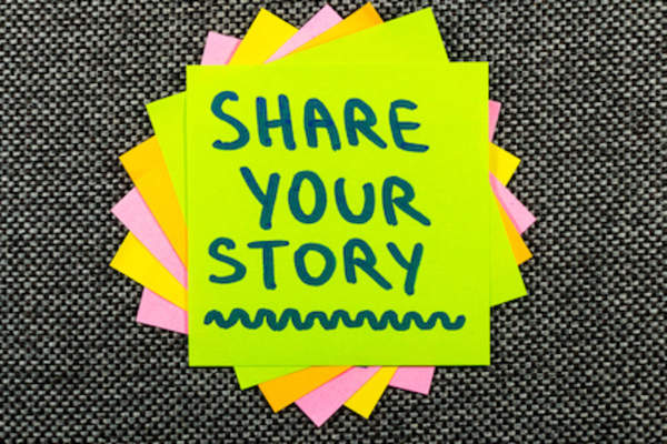 Share your story written on a sticky note.