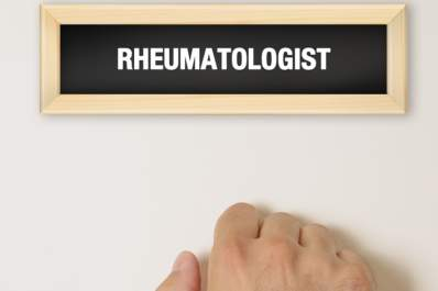 Hand knocking on rheumatologist's door.
