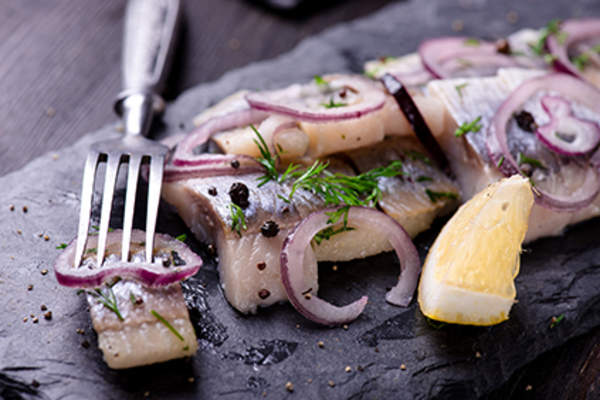Sliced herring with onions.