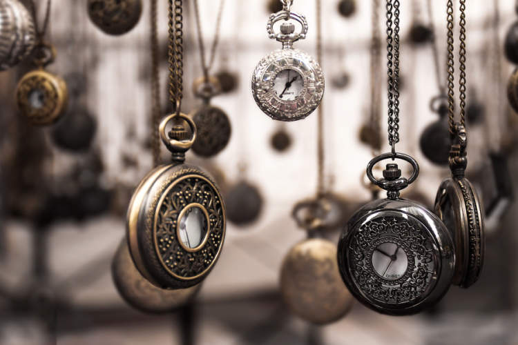 several pocket watches hanging