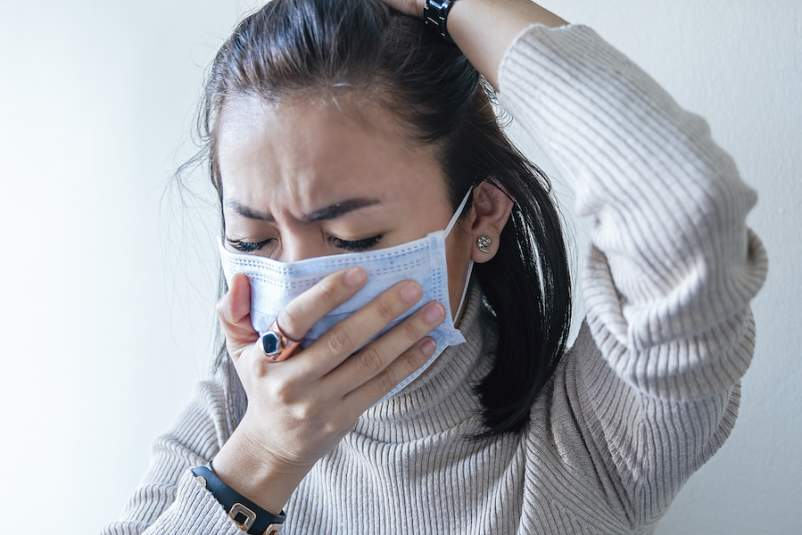 coughing with COVID-19 mask