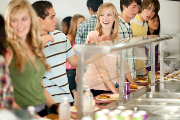 Students in line at college cafeteria.