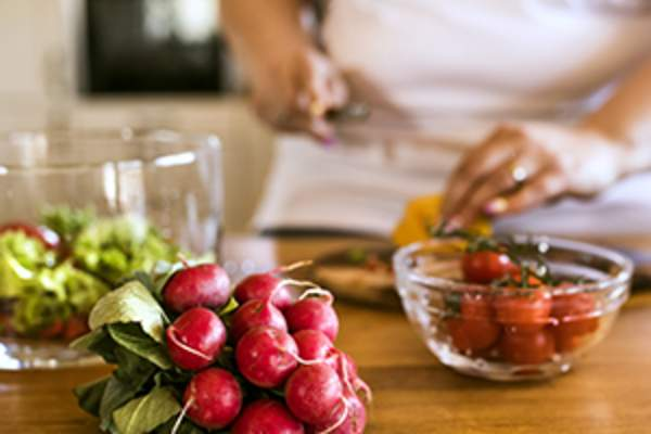 Woman preparing healthy food image.