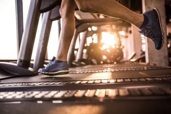 man's legs running on treadmill