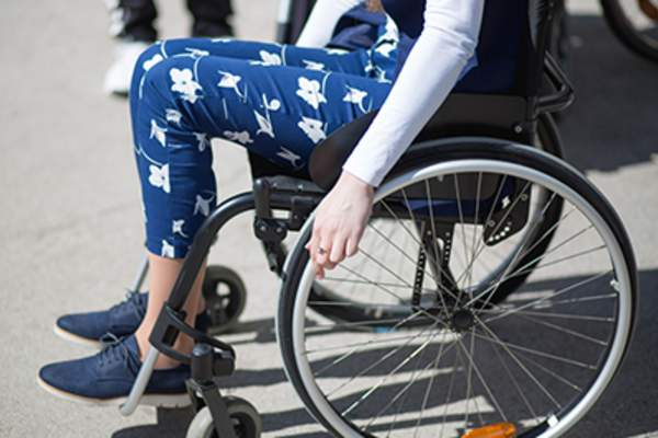Woman using a wheelchair.