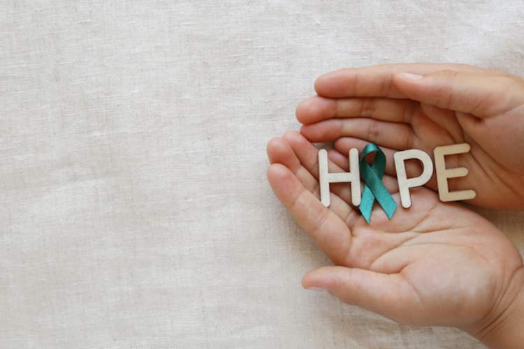 "Hands holding ""HOPE"", ""O"" is ovarian cancer awareness ribbon."