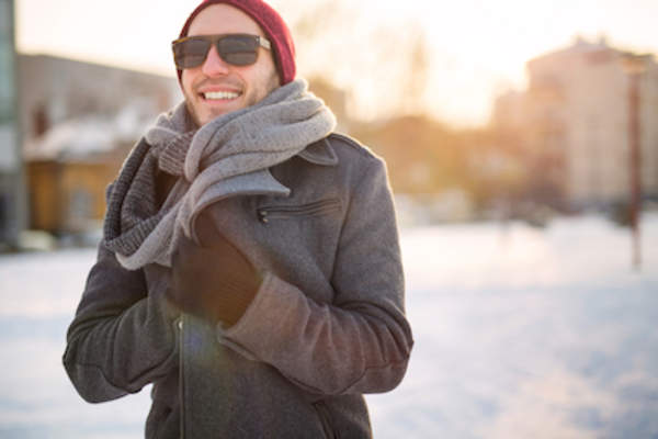 Man outside in winter wearing sunglasses.