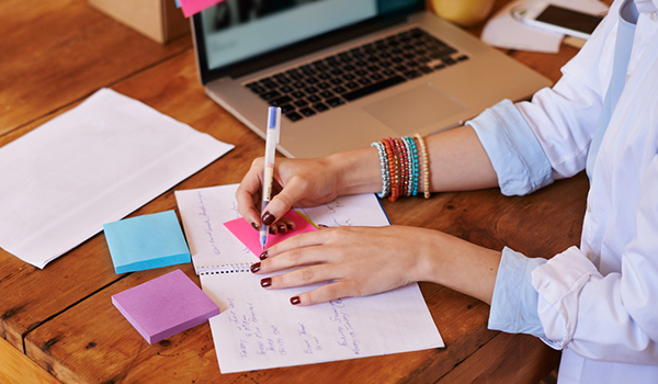 woman making schedule writing sticky notes image
