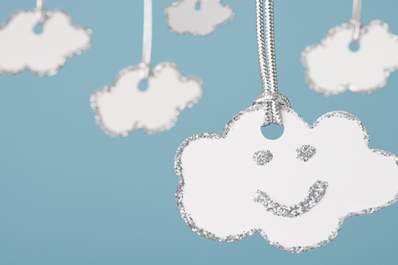Paper cloud painted with smile and a silver lining.