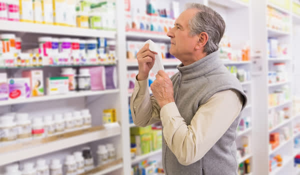 Man looking for allergy relief at store.