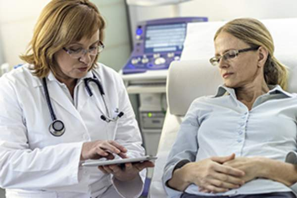 Doctor explaining test results to a patient.