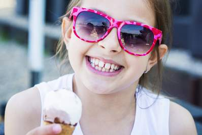 smiling girl with ice cream cone image