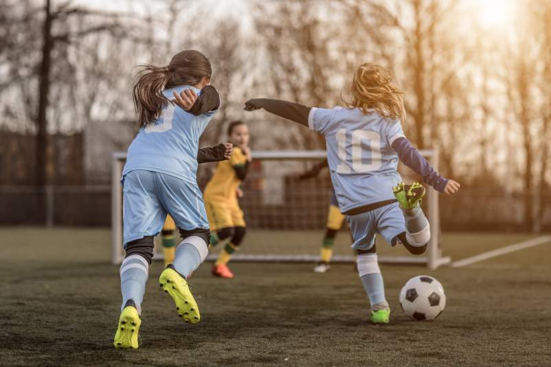 Young girls playing soccer.