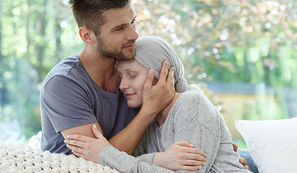 Husband comforting his wife with cancer.