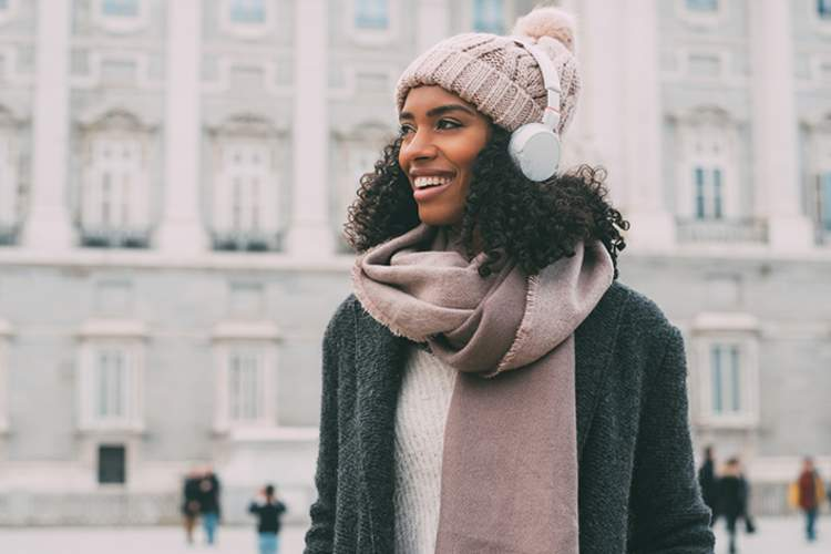Woman walking outdoors in winter.