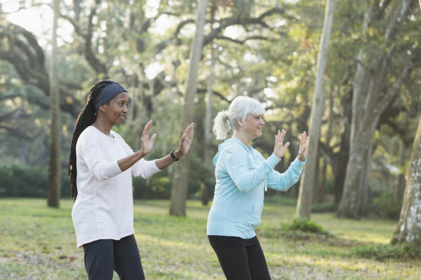 practicing tai chi in a park.