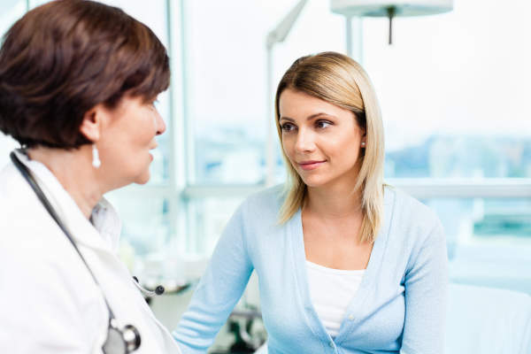 Patient having discussion with doctor