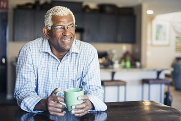 Man relaxing and drinking a cup of coffee.