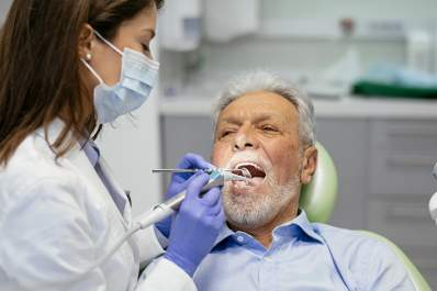 Senior man at that dentist.