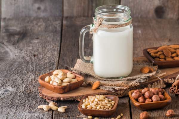Vegan milk from nuts in glass jar