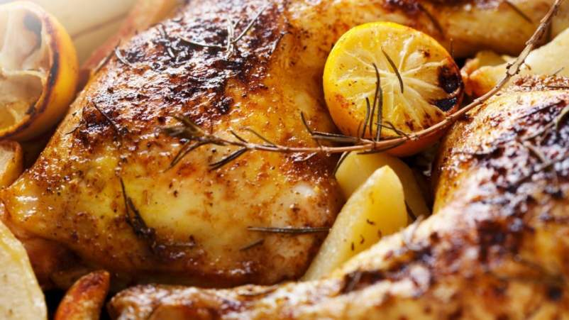 Roasted chicken with potatoes and lemons
