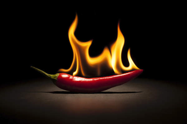 spicy pepper on fire