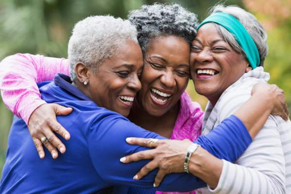 Older women embracing life and each other.