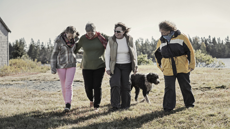 Group of friends walking with a dog.