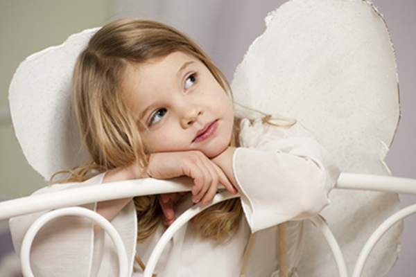 Little girl dressed as angel.